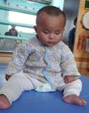 Baby Rupert sitting
