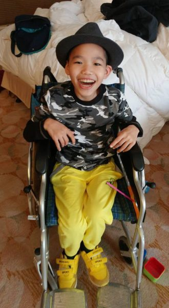 zach-in-wheelchair-smile